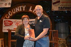 Carla presents award to Michael Stremel